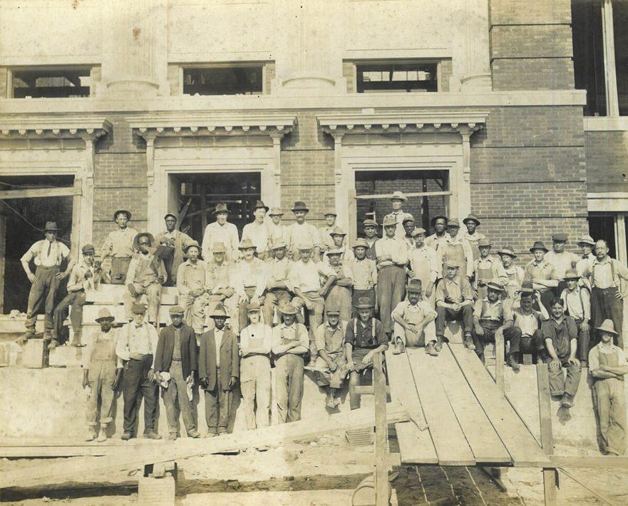 Craftsmen in front of practically complete Hammond High School, 1916