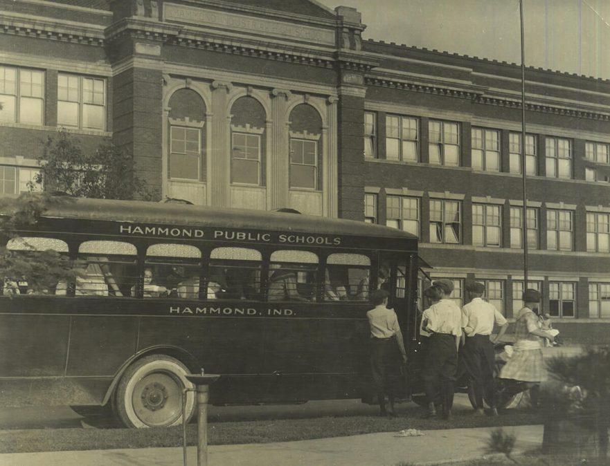 Hammond High School with school bus, circa 1922