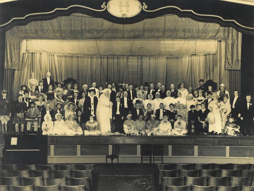 Students in costume in auditorium, 1923